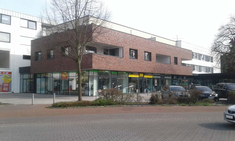 Wykonanie stanu surowego budynku mieszkalnego z częścią handlową w Garbsen, dzielnica Berenbostel (Niemcy)